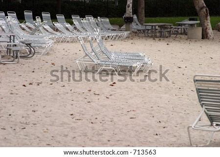 Lounge chairs sit vacant in winter