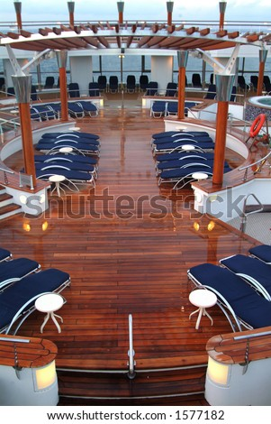 lounge deck of cruise ship with chaise lounges ready