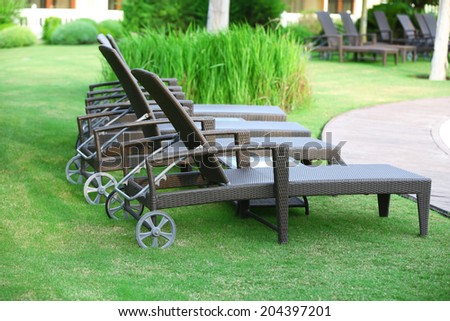 Lounge sunbed in hotel garden - stock photo