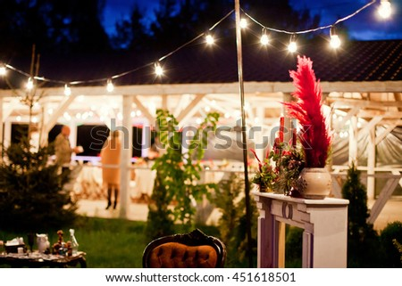 lounge zone with candles and light bulbs - stock photo
