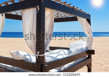 Lounger bed, on the beach for a relaxing getaway. - stock photo