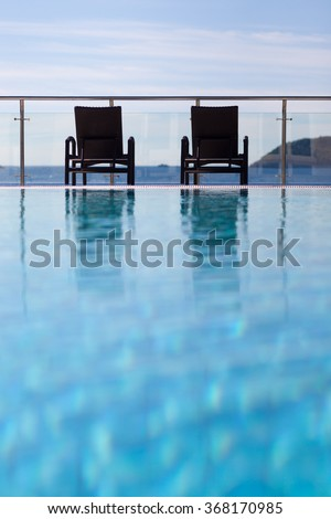loungers by the pool - stock photo