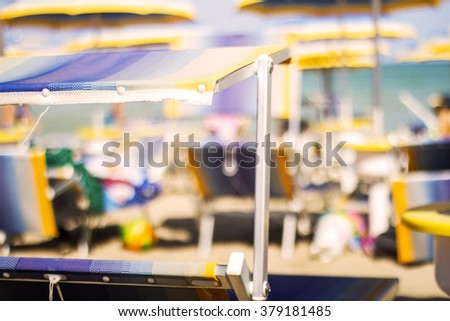Loungers on the hot beach - stock photo