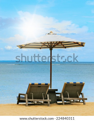 Loungers on the shores of the sunny beach