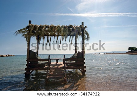 Lounges on the beach in Cesme, Turkey - stock photo
