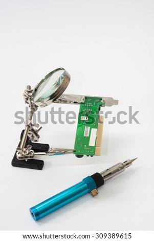 Loupe with gas soldering iron.