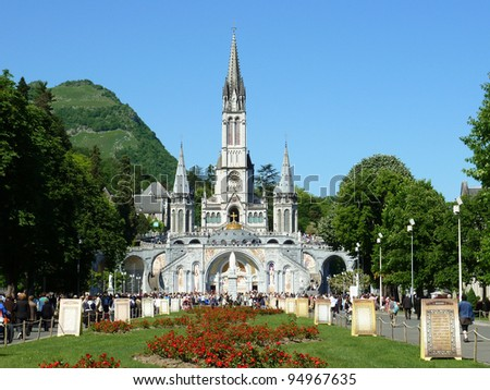 LOURDES – MAY 8: The Basilica of our Lady of the Rosary on May 8, 2011 in Lourdes (France). The Basilica of our Lady of the Rosary is a Roman Catholic church in the Sanctuary of Our Lady of Lourdes. - stock photo