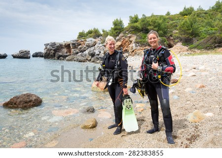 LOUTRA, GREECE - MAY 22 2015 : Two young female scuba divers ready for a dive - stock photo
