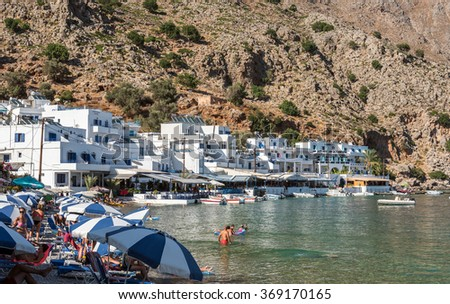 LOUTRO, CRETE, GREECE - AUGUST 2015: Tourists have a rest in small Loutro town at soth part of Crete island, Greece. Loutro is popular place among tourists who travel to south part of Crete island