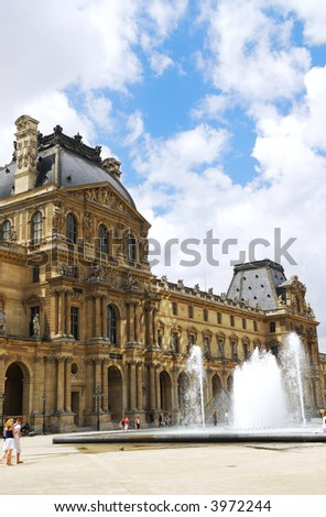 Louvre museum illuminated by sun reflections. Paris, France. - stock photo