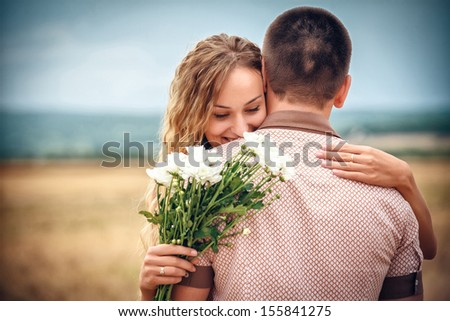 Love and affection between a young couple - stock photo