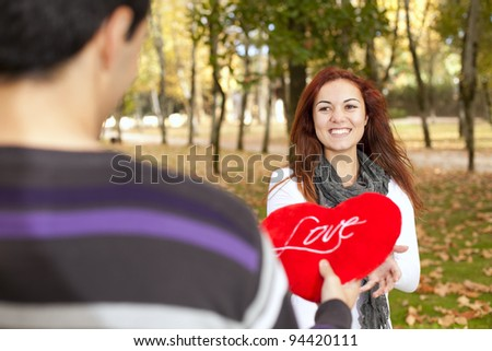 Love and affection between a young couple at valentine day (selective focus with shallow DOF)
