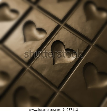 Love and chocolate. Piece of chocolate with a heart - stock photo