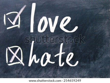 love and hate choice on blackboard - stock photo