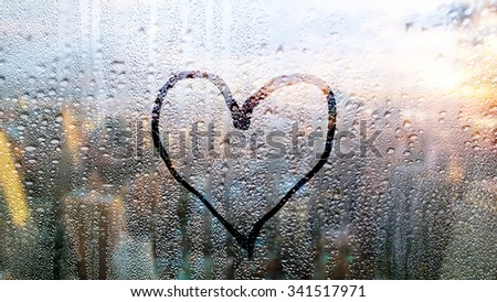 love and heart sign on the sweaty glass  - stock photo
