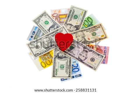 Love and money concept. Heart on European and American money - stock photo