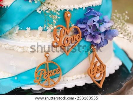 Love and peace wedding cake - stock photo