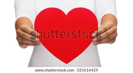 love and relationships concept - closeup of woman hands with heart