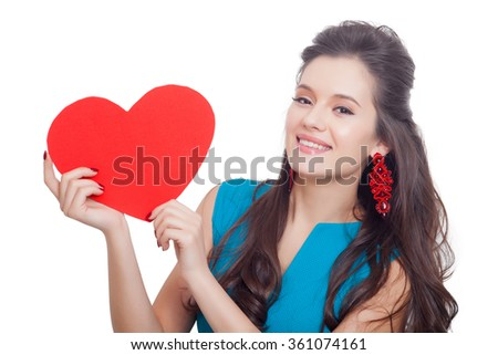 Love and valentines day. sexy woman in blue dress holding heart smiling cute and adorable - stock photo