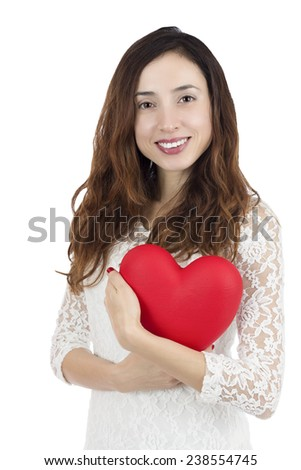Love and valentines day woman holding a red big heart