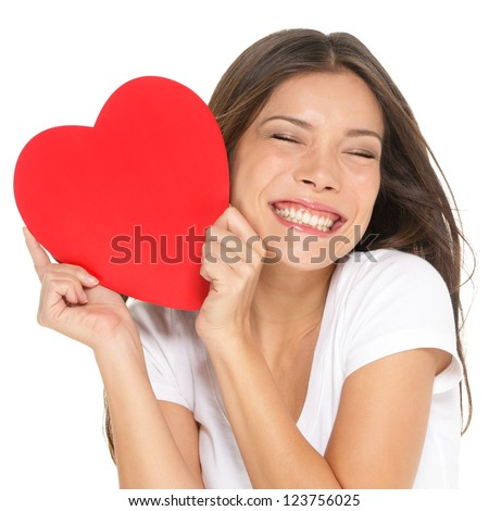 Love and valentines day woman holding heart smiling cute and adorable isolated on white background. Beautiful ethnic asian woman in love. - stock photo