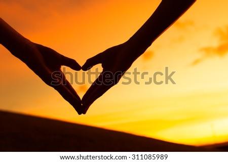 Love at sunset.  - stock photo