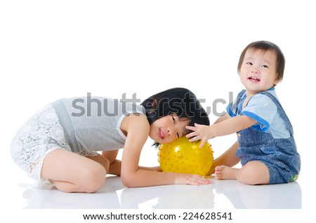 Love baby playing with his sister - stock photo