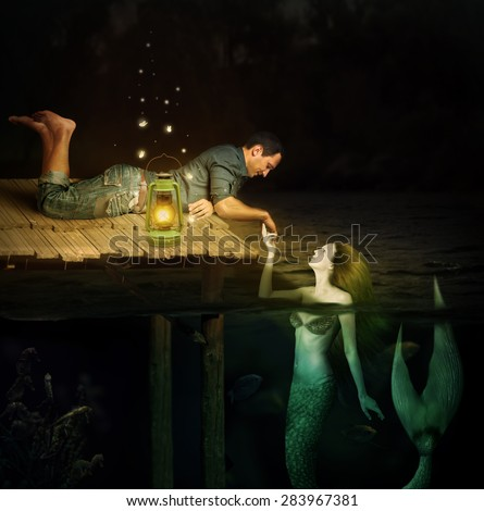 Love between handsome men and beautiful mermaid. Jetty in water - stock photo