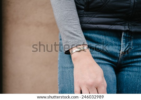 love bracelet on woman's wrist - stock photo