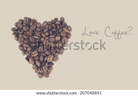 Love coffee question made with text and coffee beans in a shape of a heart. - stock photo