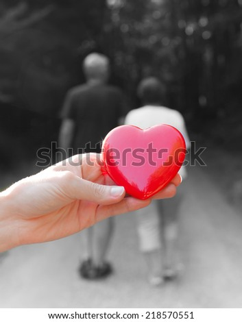 Love concept - Couple holding hands - stock photo
