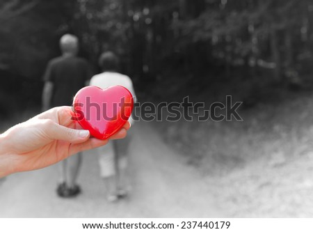 Love concept - Couple holding hands and walking away - stock photo