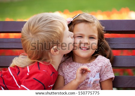 Love concept. Couple of kids loving each other hugging and kissing. - stock photo