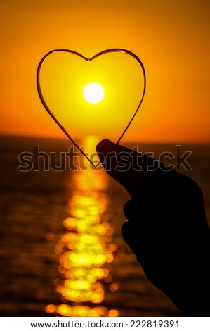 Love Concept Heart and Sun Setting on the Atlantic Ocean
