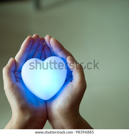 love concept. holding a heart in hands. - stock photo