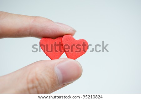 love concept. holding a red heart in hands. - stock photo