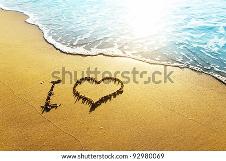 "Love concept - inscription ""I love ..."" on a beach sand"