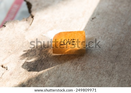 love concept. label on a wooden table.