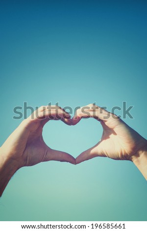 Love concept picture of two hands forming a heart shape