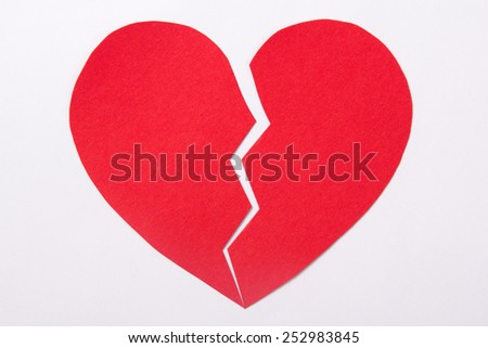 love concept - red paper broken heart over white background