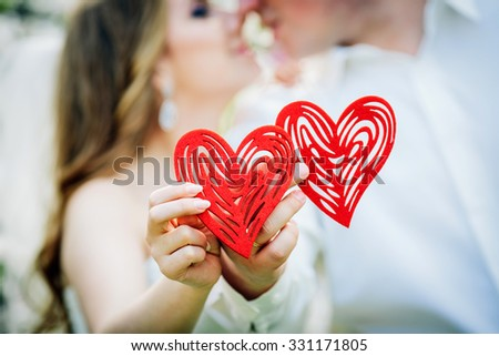 Love concept - Romantic couple kissing  and holding heart - stock photo