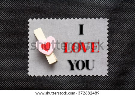 "Love conceptual background with wood clips,love shape on grey paper "" I love You"" words - stock photo"