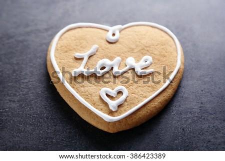 Love cookie on dark background, closeup - stock photo