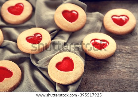 Love cookies with grey cloth on wooden background, closeup - stock photo