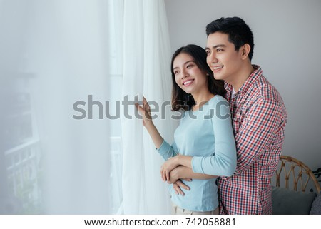 Love couple at home.  Young asian relaxing at home.