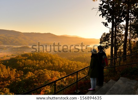 Love Couple in Autumn Pine Forest  - stock photo