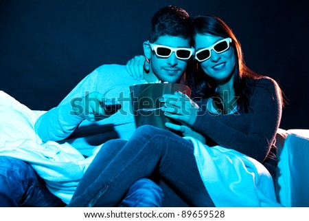 Love couple in 3D glasses at home - stock photo