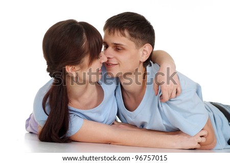 Love couple lies on a white background