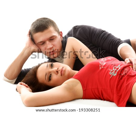 Love , couple lying on the floor,isolated on white background - stock photo