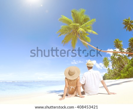 Love Couple sitting at the beach. - stock photo